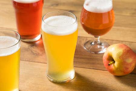 Assorted Alcoholic Hard Cider Flight in Pint Glasses Foto de archivo