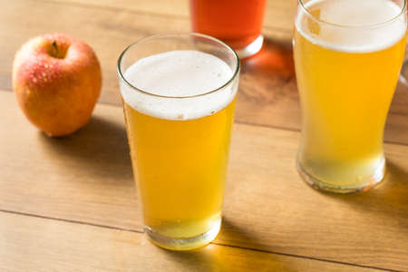Assorted Alcoholic Hard Cider Flight in Pint Glasses Stock Photo