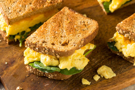 Hearty Homemade Egg Breakfast Sandwich with Lettuce and Cheese Stok Fotoğraf