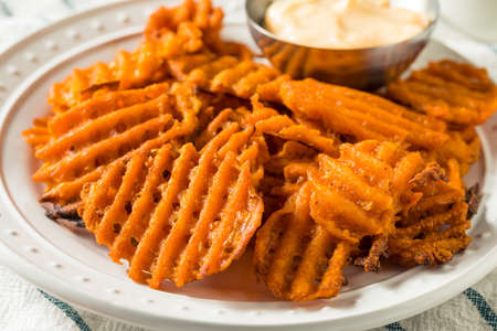 Homemade Sweet Potatoe Waffle Fries with Mayo Stockfoto
