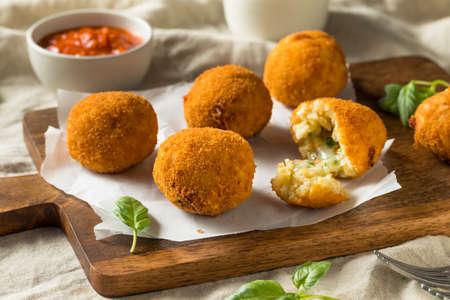 Homemade Deep Fried Risotto Arancini with Basil and Marinara