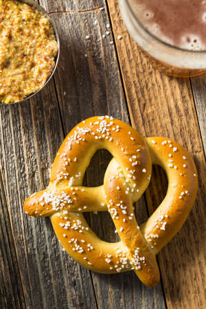 Homemade Bavarian Soft Pretzels with Mustard and Beer Stock Photo