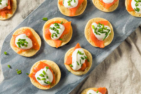 Homemade Smoked Salmon Cocktail Blinis with Creme and Chives Stock fotó