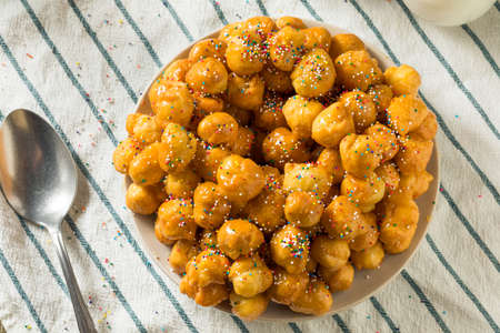 Homemade Sweet Italian Struffoli with Honey and Sprinkles