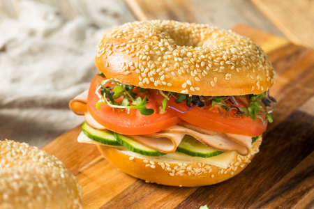 Homemade Bagel Turkey Sandwich with Tomato and Cucumber