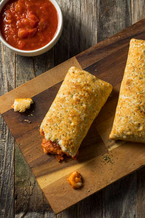 Unhealthy Microwaved Pizza Pockets with Cheese and Sauce Imagens