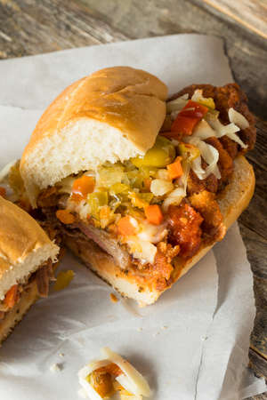 Homemade Breaded Chicago Steak Sandwich with Cheese and Giardiniera