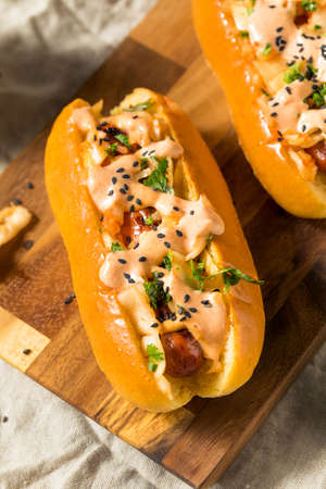 Homemade Korean Kimchi Hot Dogs with Sriracha and Sesame Seeds