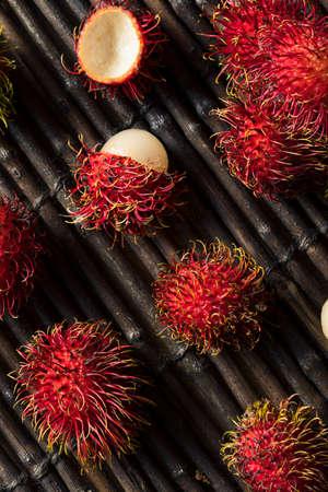 Raw Red Organic Rambutan Fruit Ready to Eat Stock Photo