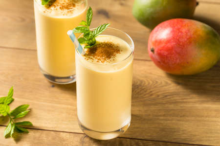 Homemade Sweet Indian Mango Lassi Smoothie with Mint 스톡 콘텐츠