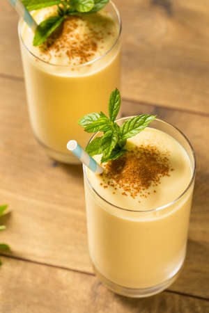 Homemade Sweet Indian Mango Lassi Smoothie with Mint Stock Photo