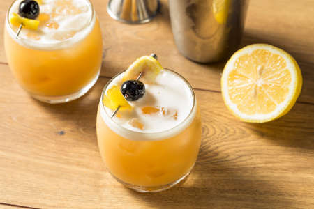 Sweet Homemade Whiskey Amarreto Sour Cocktail with a Cherry