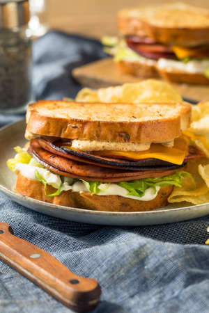 Homemade Fried Bologna Sandwich with Cheese and Lettuce