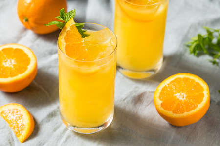 Homemade Orange Crush Cocktail with Mint and Vodka Stockfoto
