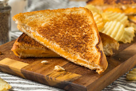 Homemade Grilled Cheese Sandwich with Potato Chips Stock Photo