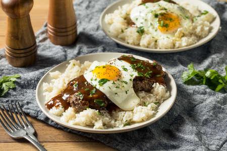 Homemade Hawaiian Loco Moco with Hamburger and Rice Stock Photo