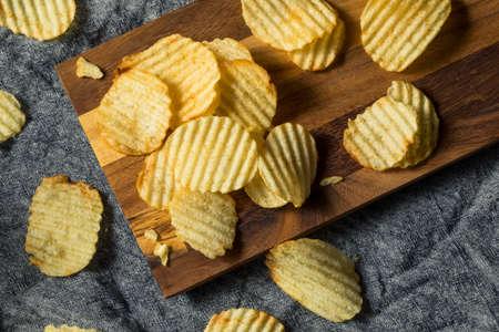 Organic Salted Wavy Potato Chips Ready to Eat Foto de archivo