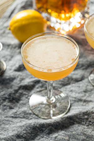 Homemade Lemon Brandy Daisy Cocktail with Soda Water Foto de archivo