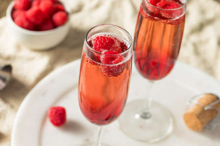 Refreshing Alcoholic Kir Royale with Champagne Raspberries Stock fotó