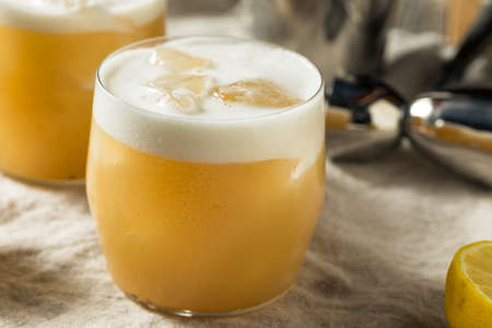 Alcoholic Tequila Lemon Sour Cocktail with Egg White