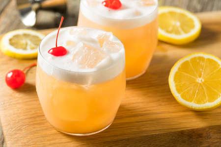 Refreshing Raki Vodka Sour Cocktail with a Cherry Standard-Bild