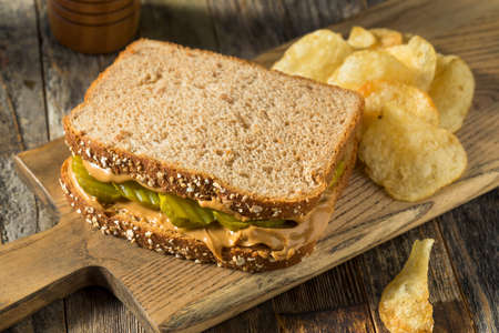 Homemade Peanut Butter and Pickle Sandwich with Chips