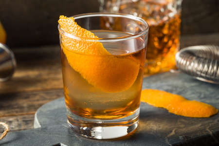 Refreshing Bourbon Old Fashioned Cocktail with Round Ice Cube