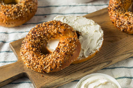 Homemade Toasted Everything New York Bagel with Cream Cheese Archivio Fotografico