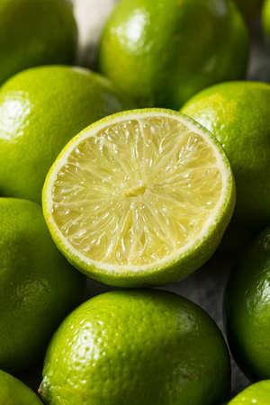 Raw Organic Green Limes in a bunch