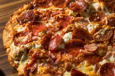Savory Homemade Meat Lovers Pizza with Pepperoni and Bacon