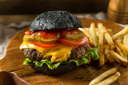 Homemade Cheeseburger with a Black Charcoal Bun and Fries