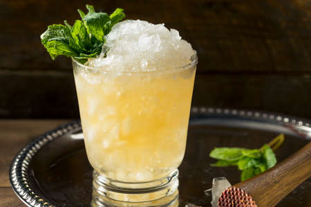 Frozen Boozy Bourbon Mint Julep in a Glass Banque d'images