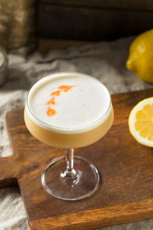 Homemade Boozy PIsco Sour Cocktail with Bitters