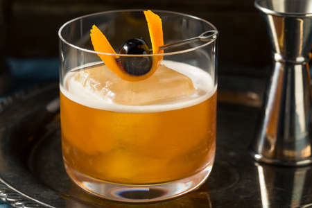 Coffee Old Fashioned Cocktail with Cherry and Orange