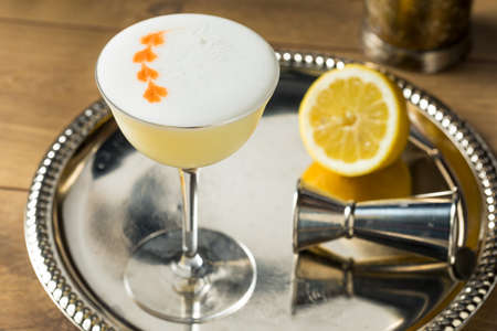 Sweet Boozy Whiskey Pisco Sour with Lemon and Angastora