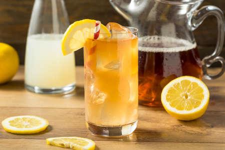 Refreshing Cold Lemonade and Iced Tea with a Lemon