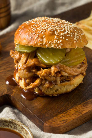 Homemade BBQ Pulled Chicken Sandwich with PIckles and Fries
