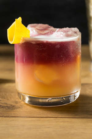 Homemade New York Sour Cocktail with Bourbon and Wine