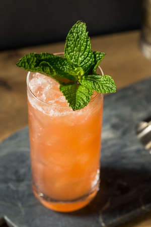 Homemade Refreshing Zombie Tiki Drink Cocktail with Pineapple and Mint Banque d'images