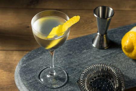 Boozy Dry Vesper Martini Cocktail with a Lemon Peel