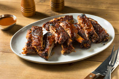 Homemade Smoked St Louis Style Spare Ribs with BBQ Sauce Stock Photo