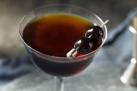 Refreshing Boozy Black Manhattan Cocktail with Amaro and Rye 免版税图像