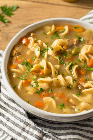 Homemade Chicken Noodle Soup with Peas and Carrots