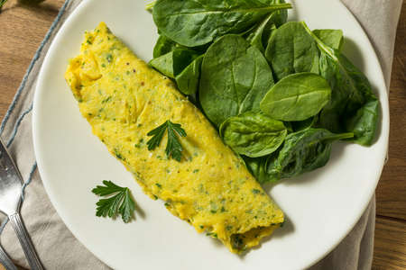 Homemade Breakfast French Omelette with Herbs and Greens