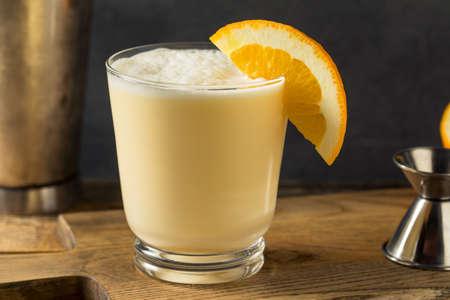 Homemade Boozy Orange Whip Cocktail with Cream Stock Photo