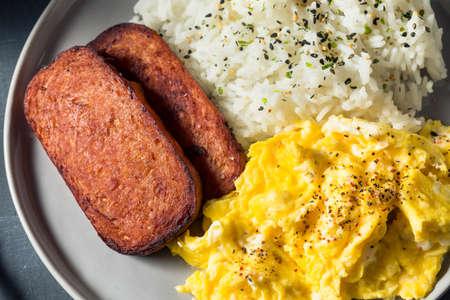 Homemade Hawaiian Egg Breakfast with Ham and Rice Stock Photo