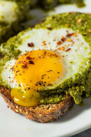 Healthy Organic Pesto Egg Toast for Breakfast with Pepper