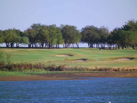 Golf course by lake