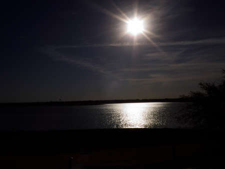 midmorning sun over area lake