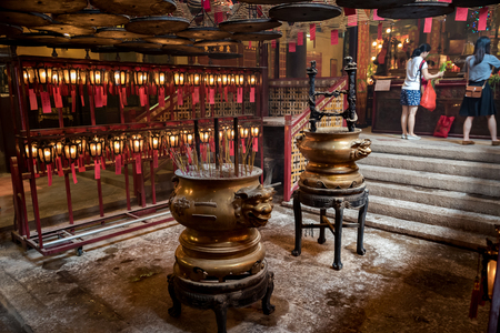 mo: Interior circular incenses in Man Mo Temple in Hong Kong Editorial